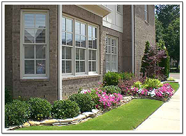Exterior of Home with Flowerbed